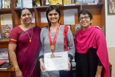 Felicitating Ms. Kushali Shah, Gold Medallist of Maharashtra University of Health Sciences, Nashik in first BASLP summer 2018